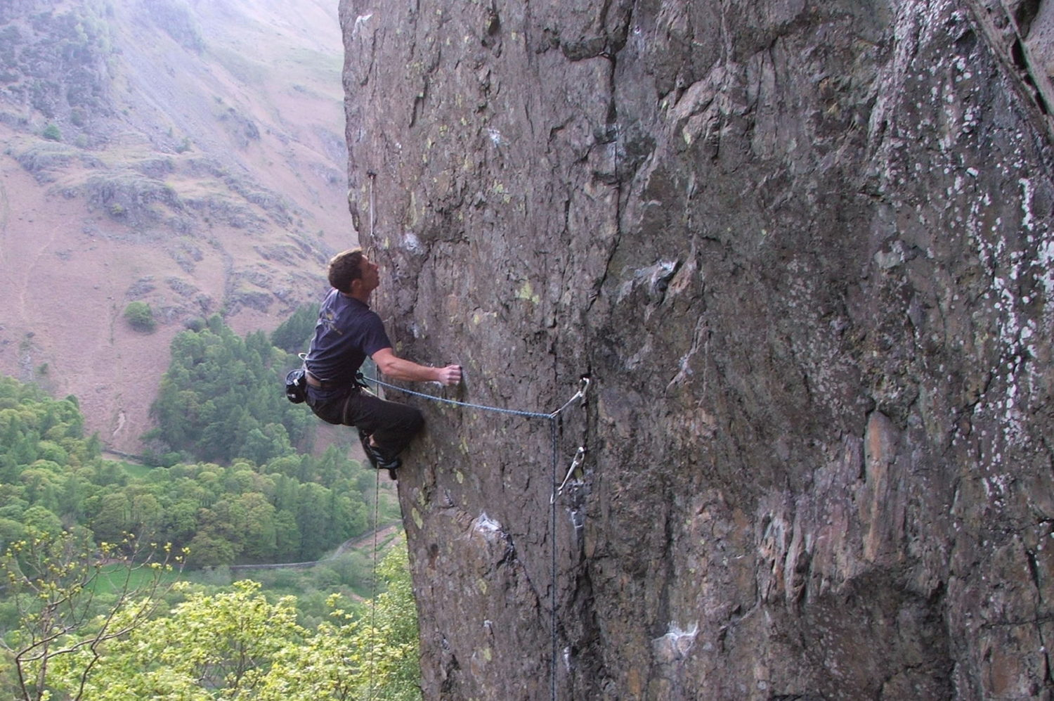 Climbing Inferno on Bowderstone Crag
