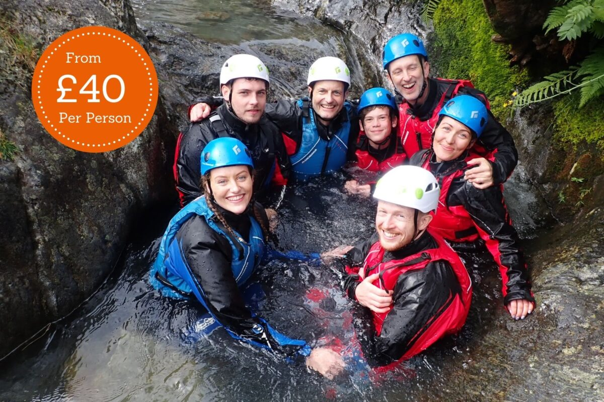A group enjoying Ghyll Scrambling in the Lake District